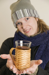 woman offer the tea glass
