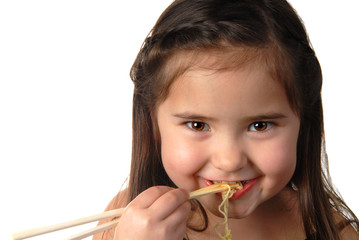 Young girl eating noodle soup