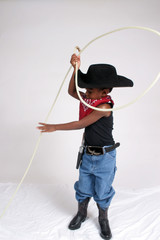 African american child cowboy and his rope