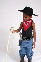 young african american boy playing cowboy