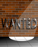 Wanted sign in the spotlight on a brick wall
