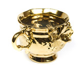 The gold coffee cup ornate on white