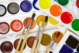 Set of brushes on a background of water colour paints