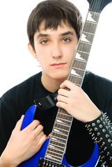 young man embracing his guitar