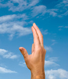 Crossed fingers symbolizing good luck poster