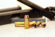 .40 caliber bullets with dissasembled gun in background