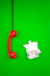 Money and red phone on green