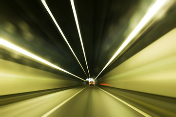 Cars moving fast in tunnel