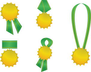 set of golden medals with green ribbons