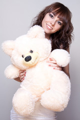 beautiful girl with a teddy bear