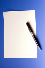 modern pen and sheet of white paper