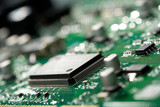 microchip on green circuit board poster