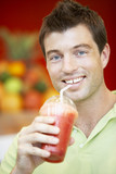 Man Drinking A Berry Smoothie