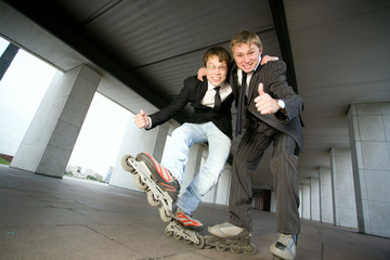 Two Men Wearing  Rollerblades