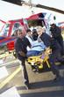 Paramedics unloading patient from Medevac - 12969701