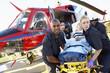 Paramedics unloading patient from Medevac
