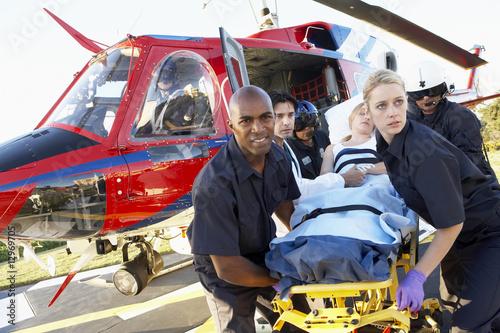Leinwanddruck Bild Paramedics unloading patient from Medevac