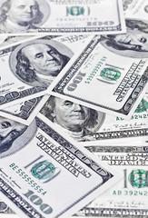 Scattered 100 dollars bills