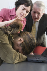 View of business people consoling colleague.