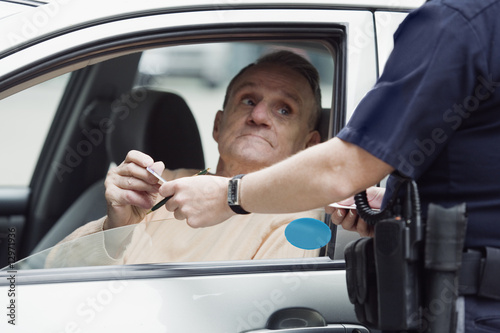 Police sergeant checking driver's license.