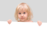 Little girl holding a white banner