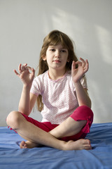 Young woman doing yoga moves or meditating. You can use top part