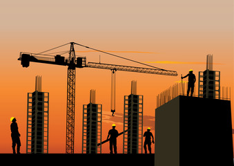 Construction site silhouette with workers at sunset