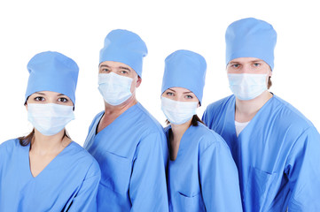 group of surgeons in medical blue uniform