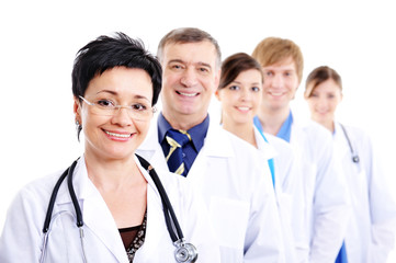mature female doctor with group colleagues