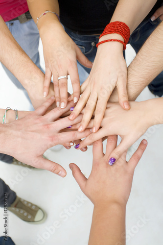hands on top of each other; teamwork concept