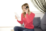 reading invoice and talking on cellphone poster