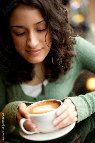 A Young Woman with a Latte