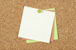 Post-it notes pinned to corkboard