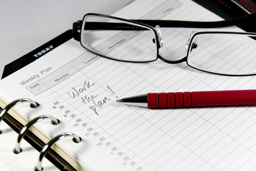 Picture of business diary with spectacles and pen