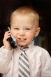 Smiling little boy with phone