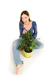 Woman on the floor cutting plant poster