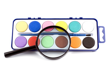 magnifying lens and paints