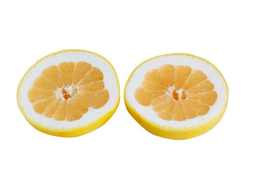 Slices of grapefruits on a white.