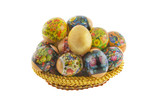 Many easter decorated eggs lying in a basket weaved from straw i poster