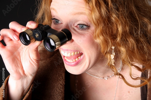 astonished woman with binoculars
