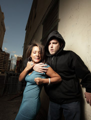 Woman elbowing a man who was trying to assault the woman