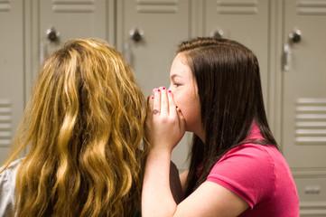 Teenage girls telling secrets
