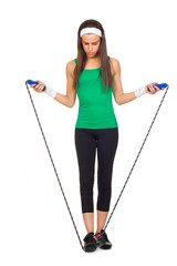 Young beautiful woman in fitness with jump rope