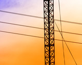 Electric powerlines,sunset poster