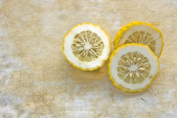 study of slices of lemon on a rough marble background