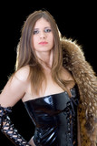 Young woman in latex suit with a fur coat poster
