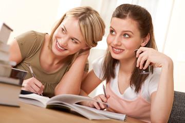 Student series - Two girls doing homework