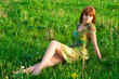 Young beautiful girl sitting on the grass