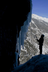 man climbing on an icefall