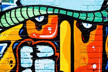 Graffiti detail on a textured brick wall